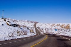 Desert road in snow Royalty Free Stock Images
