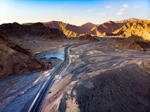 Desert road surrounded by sandstones aerial view. Desert road surrounded by sandstone rocks aerial view stock images