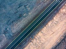 Desert road surrounded by sandstones aerial view. Desert road surrounded by sandstone rocks aerial view royalty free stock image