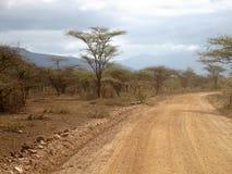 Desert road in Tsavo East National Park Royalty Free Stock Images