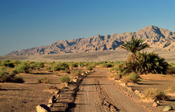 Desert road in valley of Arava, Eilat, Israel. This shot was taken in Evrona desert reservation park, 5 miles north of Eilat city, Israel Stock Photography