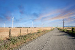 Desert Road through Wind Turbines Farm on California Hills Stock Photos