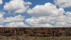 Desert Rock Cliff and Clouds stock photo