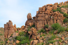 Desert Rock Outcropping. An outcropping of orange rocks in the Sonoran Desert near Phoenix, Arizona stock images