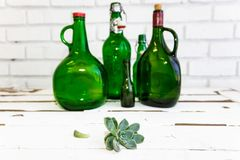 Vintage green glass bottle and desert rose Royalty Free Stock Photography