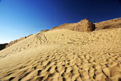 Desert  with rotten ancient city wall Royalty Free Stock Image
