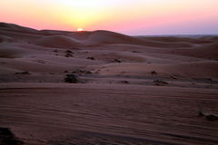 Desert Safari. Dune bashing near Dubai, at Sunset royalty free stock images