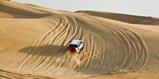 Desert Safari. A vehicle doing Adventurous activities in desert royalty free stock photos