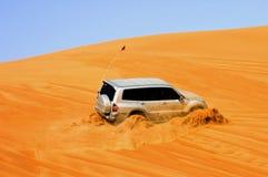 Desert Safari. A four wheel drive car travelling along the desert of Dubai royalty free stock photography