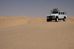 Desert Safari. Off-road vehicle in the desert in Namibia stock photos