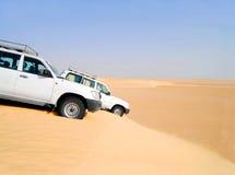 Desert safari. Two cars on a sand dune in the Sahara Desert royalty free stock photo