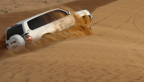 Desert Safari Adventure. A 4-weel drive car in action in a desert safari trip stock photo