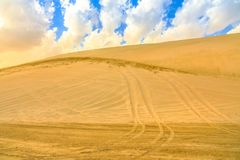Desert safari adventure. At Khor Al Udeid, Persian Gulf, Middle East. Desert landscape sand dunes near Qatar and Saudi Arabia. Inland sea is a major tourist stock photography