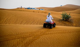 Desert safari in Dubai. ABU DHABI, UAE - FEBRUARY 01: Desert safari in Dubai, United Arab Emirates. Dune bashing by a 4x4 car is a very popular activity royalty free stock photos