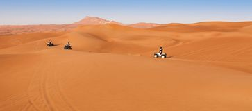 Desert safari experience with atv 4x4. Vehicles royalty free stock photo