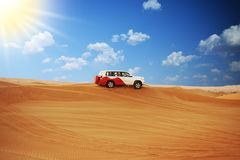 Desert safari with off road 4x4 car in sunlight royalty free stock image