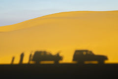 Desert Safari. The shadow of 4 wheel drive cars on a sand dune at sunset in a safari trip in the desert of fayoum, Egypt Royalty Free Stock Image