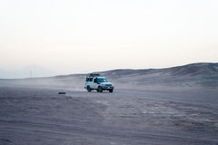 Desert safari suv car driving through sand dunes, Hurghada, Egypt Royalty Free Stock Image
