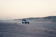 Desert safari suv car driving through sand dunes, Hurghada, Egypt royalty free stock photography