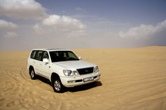 Desert safari. 4WD vehicle on the desert sand. An off-road desert safari is a popular tourist attraction in the Middle East. Southern Qatar royalty free stock image