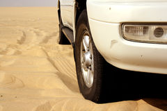 Desert safari. 4WD vehicle on the desert sand. An off-road desert safari is a popular tourist attraction in the Middle East. Southern Qatar Royalty Free Stock Photography