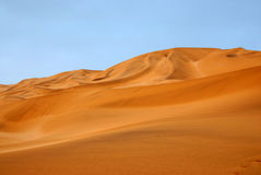 Desert and Sand. Desert landscape against a blue sky Stock Photos