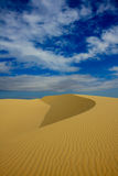 Desert sand dune. A sand dune under a blue sky in Vietnam royalty free stock images