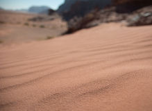 Desert sand dune. Close-up, golden sand colors Stock Photography