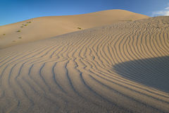 Desert sand dune with ripples in the sand. Ripples textures of a Sand dune during the day Stock Photography