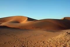 Desert sand dunes. Against clear blue sky royalty free stock photos