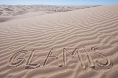 Desert sand dunes. The letters GLAMIS written in desert of Imperial Sand Dunes on hot sunny day Royalty Free Stock Photo