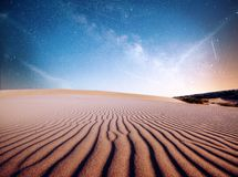 Desert sand dunes in night, stars and milky way, deep sky astrophoto.  royalty free stock image