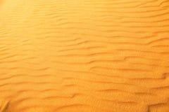 Desert sand dunes. Red and yellow desert sand dunes texture royalty free stock image