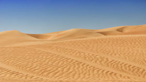 Desert sand and dunes. Desert sand, tracks and dunes - Oman royalty free stock image