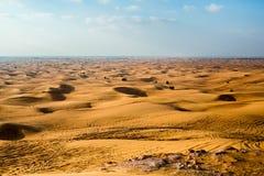 Desert and Sand Dunes in Twilight. Dubai. Stock Photo