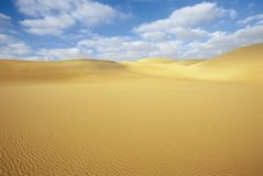 Desert and sand dunes under blue sky Royalty Free Stock Images