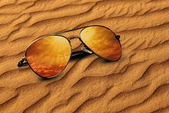 Desert sand and Sunglasses Reflection Vacation Concept. Desert sand and Sunglasses Vacation Concept Stock Photos