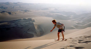 Desert sandboarding. The desert in Southern Peru is a mecca for thrill seekers Royalty Free Stock Image