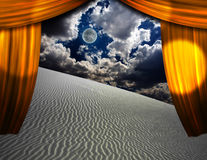 Desert Sands seen through opening in curtains Royalty Free Stock Photography