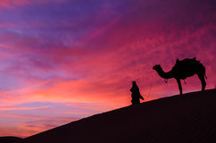 Desert scence with camel and dramatic  sky. Rajasthan desert with dramatic sky with camel and man Royalty Free Stock Image