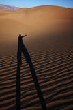Desert scene. Mysterious silhouette in the desert dunes Royalty Free Stock Image
