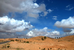 Desert scenery with beautiful sky. Photo of desert landscape with beautiful sky taken in north africa in tunisia Royalty Free Stock Photography
