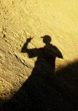 Desert shadow. Of a man with cap Royalty Free Stock Photography