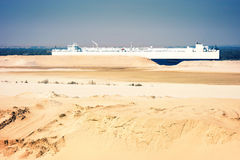 Desert ship -freightship traverses the Suez Canal in the directi Stock Image