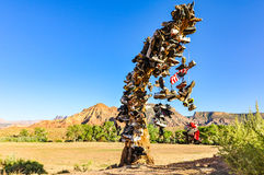 Desert Shoe Tree - Utah. Dead tree in Virgin, Utah covered in shoes tossed by visitors, symbolizing victory after completing desert hike Royalty Free Stock Photography