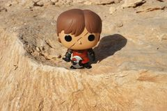 Riyadh / Saudi Arabia - February  15, 2019: Pop Funko toy model of slashed faced Tyrion Lannister with ax in full battle gear. Desert shooting of Pop Funko toy royalty free stock photography