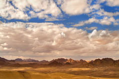 Desert Sinai. The sun and clouds above mountains of desert Sinai Royalty Free Stock Image