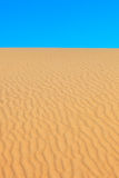 Desert and sky. Sand dune molded by wind. Portuga Royalty Free Stock Photo