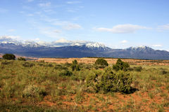 Desert and snow. Desert landscape and snow on the mountains in Utah Royalty Free Stock Image