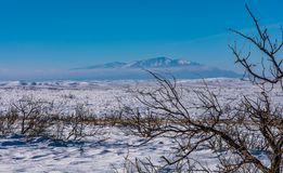 Desert Snow with distant mountains Royalty Free Stock Image